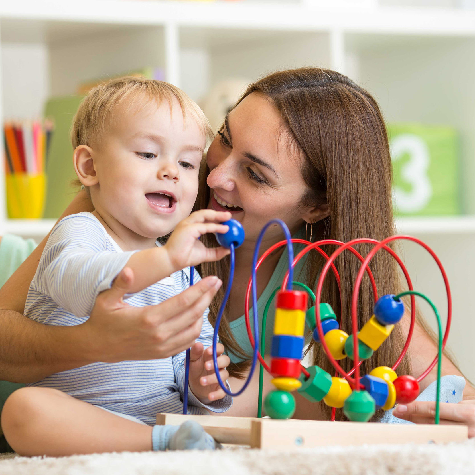 Mother and baby playing with a sensory toy